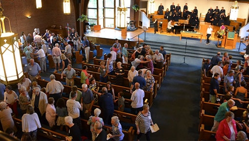 Gathering of people inside of a church