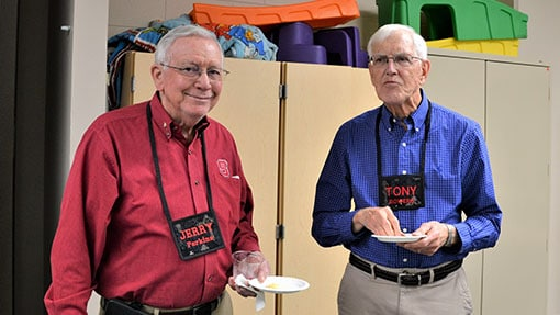 Two senior adults sharing a meal in a classroom