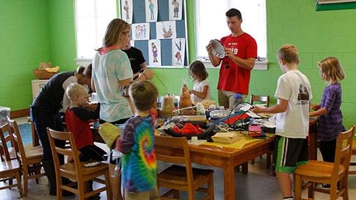 Teachers leading kids in craft activity