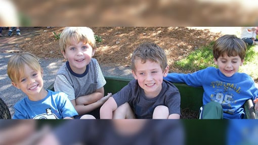 Four kids playing outside